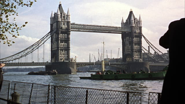 ms view of tower bridge over thames river, london - london bridge england stock videos and b-roll footage