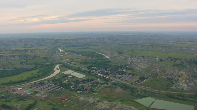 WS AERIAL View of Town and badlands / Medora, North Dakota, United States