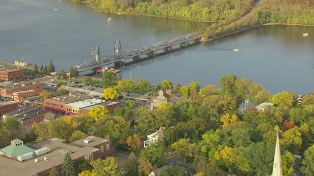 ws aerial zi view of town and push in to old sawmill / stillwater, minnesota, united states - timber yard stock videos & royalty-free footage