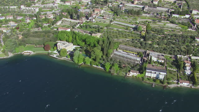 WS AERIAL View of town besides lake / Lake Garda, Trentino, Verona, Brescia