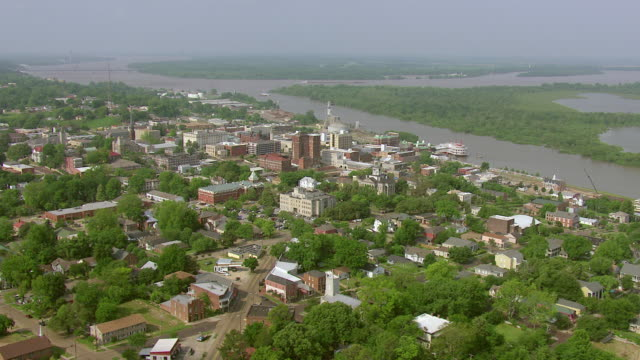WS AERIAL View of town buildings and streets and landscape with Mississippi River / Vicksburg, Mississippi, United States