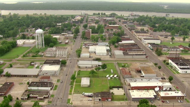 WS AERIAL View of town buildings and streetscape to Mississippi River / Greenville, Mississippi, United States