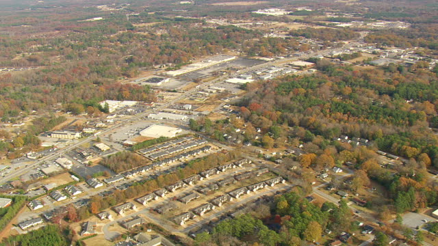 ws aerial view of town city with greenwood area / south carolina, united states - carolina del sud video stock e b–roll