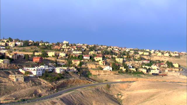 aerial pan view of town in negev desert / arad, sourn judea desert, israel  - negev stock videos & royalty-free footage