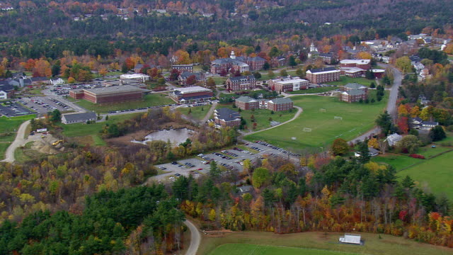 stockvideo's en b-roll-footage met ms aerial zi view of town near colby-sawyer college building at new london / new hampshire, united states - new hampshire