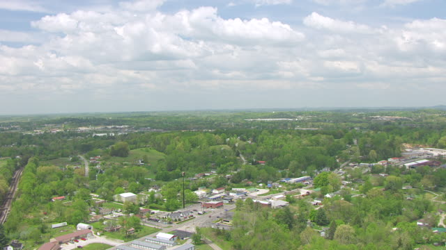 ws aerial view of town streets and buildings / corbin, kentucky, united states - kentucky stock videos & royalty-free footage