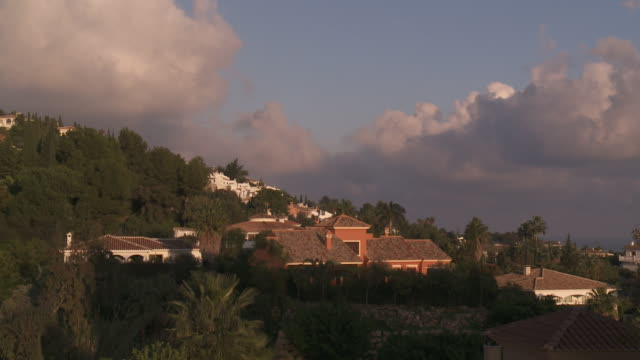 WS T/L View of town surrounded by tree at sunset / Marbella, Andalusia, Spain