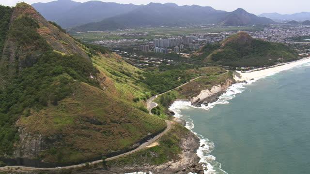 ws aerial view of town with coastline / rio de janeiro, brazil - coastal road stock videos & royalty-free footage