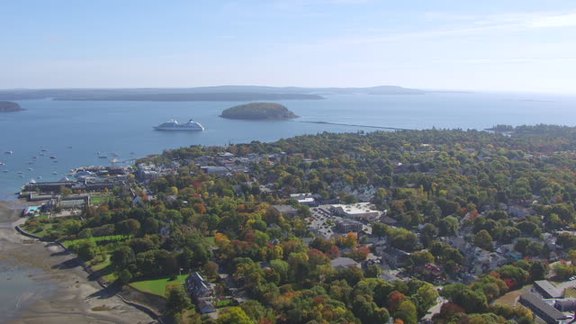 WS AERIAL POV View of town with cruise ship in background/ Bar Harbour, Maine, United States