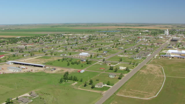 WS AERIAL View of town with houses and streetscape / Greensburg, Kansas, United States