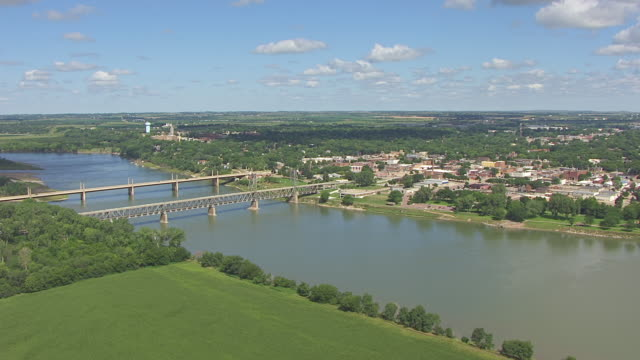 ws aerial view of town with missouri river and blue sky with white clouds / yankton, south dakota, united states - south dakota stock videos and b-roll footage