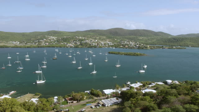 WS PAN AERIAL POV View of town with sailing boat anchored in bay / Culebra, Puerto Rico, United States