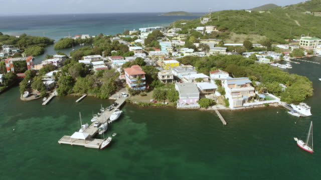 ws tu aerial pov view of town with sailing boat anchored in bay / culebra, puerto rico, united states - puerto rico stock videos & royalty-free footage