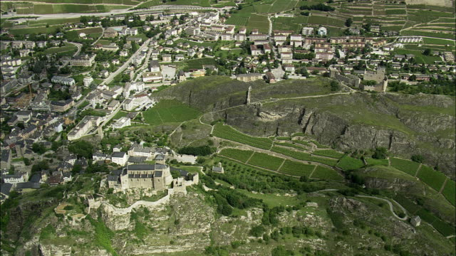 AERIAL View of town with Valere basilica and Tourbillon castle, Sion, Valais, Switzerland