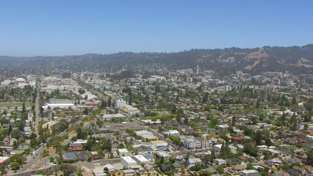 WS AERIAL POV View of townscape and Berkeley hills / Berkeley, California, United States