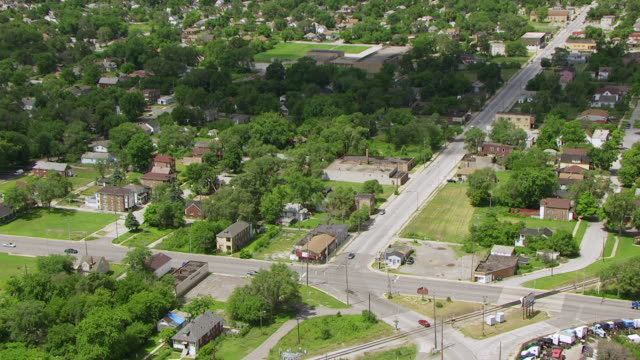WS AERIAL POV ZI View of townscape and car standing in road signal / Lake County, Gary, Indiana, United States