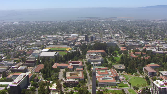 WS AERIAL POV View of townscape and Sather Tower, University of California / Berkeley, California, United States