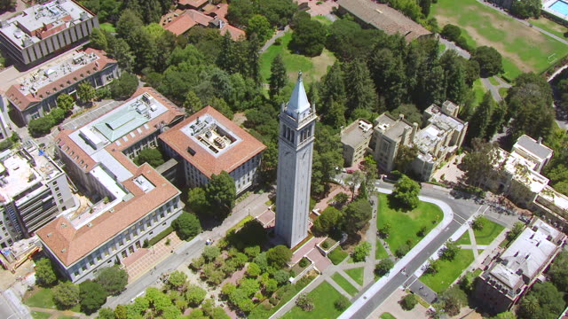 WS ZI AERIAL POV View of townscape and Sather Tower, University of California Memorial Stadium / Berkeley, California, United States