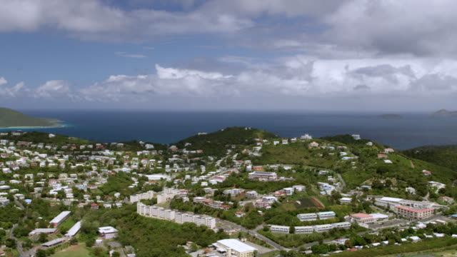 ws pan aerial pov view of townscape with bay in background / tutu, saint thomas, us virgin islands, united states - tutu stock videos & royalty-free footage
