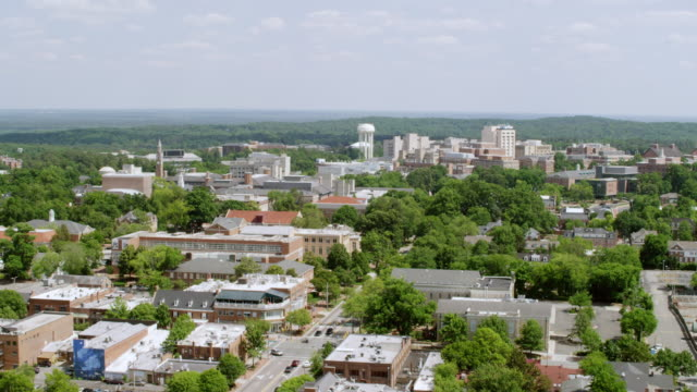 ws aerial pov view of townscape with bell tower and old east campus building / chapel hill, north carolina, united states - school bell stock videos & royalty-free footage