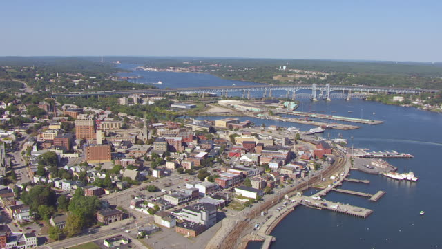 ws aerial pov view of townscape with bridge in background / new london, connecticut, united states - new london county connecticut stock videos & royalty-free footage