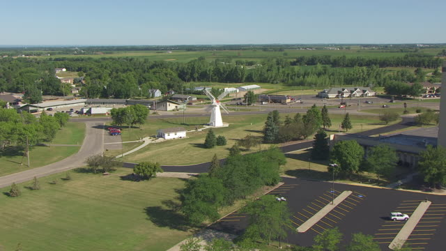 ms aerial tu ts view of track along grass field to push over trees to fly over old grist mill / milbank, south dakota, united states - south dakota stock videos and b-roll footage