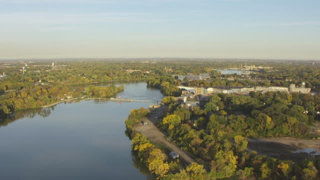 WS AERIAL View of track down Fox River / Appleton, Wisconsin, United States