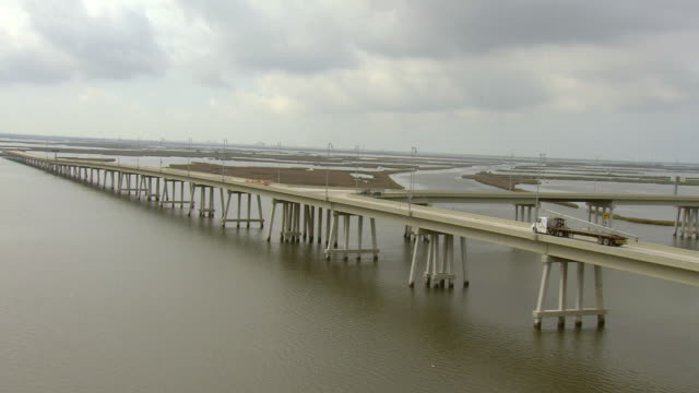 ws aerial view of tracking leeville bridge section of highway la 1 over water / louisiana, united states - bayou lafourche stock-videos und b-roll-filmmaterial