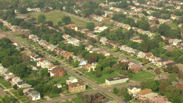 ws aerial view of  tracking over western detroit neighborhoods towards dearborn / detroit, michigan, united states - detroit michigan stock videos & royalty-free footage