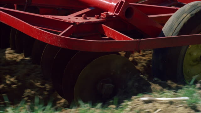 ms cu view of tractor wheels and harrow wheels  - harrow agricultural equipment stock videos & royalty-free footage