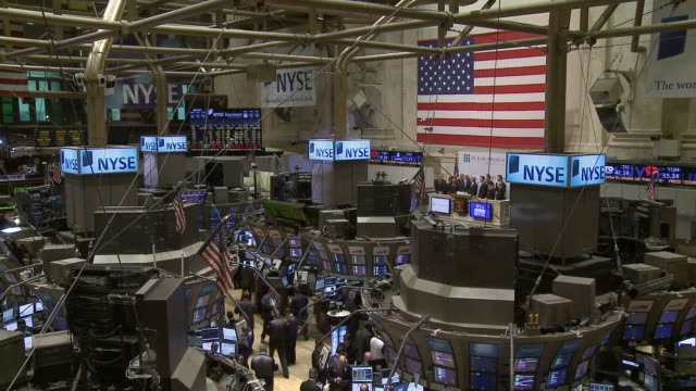 ws view of traders working in new york stock exchange / new york city new york usa - bull market stock videos & royalty-free footage