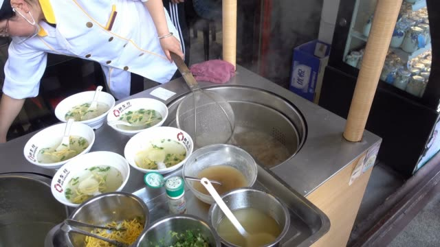 view of traditional chinese snack - wonton on may 20, 2017 in shanghai, china. - ダンプリング点の映像素材/bロール