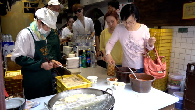 a view of traditional chinese snacks stinky tofu on may 20 2017 in shanghai china - unpleasant smell stock videos & royalty-free footage