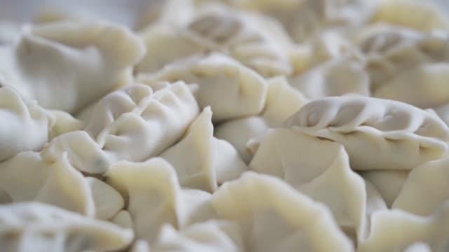 伝統的な餃子(ジアオジ)、中国の眺め。 - ダンプリング点の映像素材/bロール
