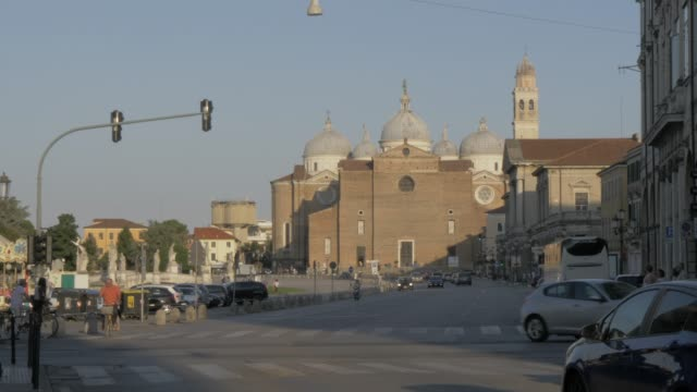 view of traffic and abbey of santa giustina on prato della valle, padua, veneto, italy, europe - prato stock videos and b-roll footage
