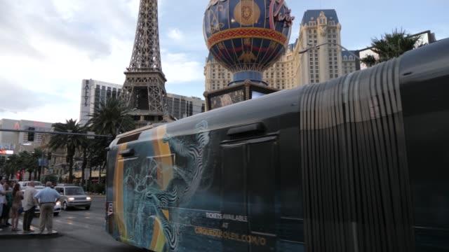 view of traffic and paris hotel and casino on the strip, las vegas boulevard, las vegas, nevada, united states of america, north america - paris las vegas stock videos & royalty-free footage