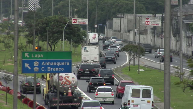 ws view of traffic and road sign on street / sao paulo, brazil - road sign stock videos & royalty-free footage