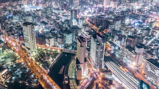 t/l ls ha view of traffic and skyscrapers in yokohama at night / yokohama, japan - yokohama stock videos and b-roll footage