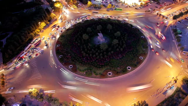 HA T/L View of traffic around a planted roundabout at night  /Xi'an, Shaanxi, China