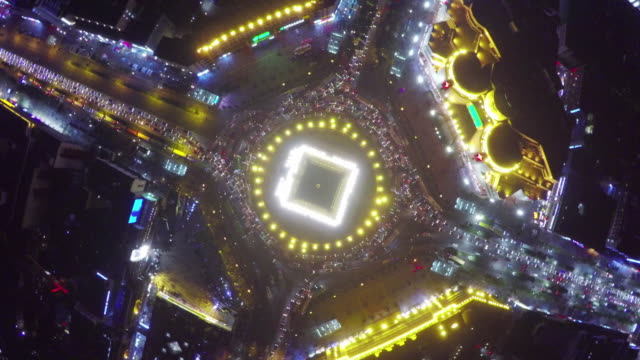 WS AERIAL View of traffic around Bell Tower in rushhour at night, Xi'an,China.