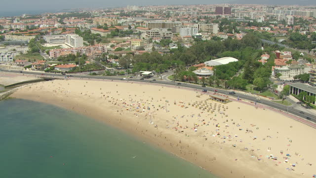 ws aerial zi view of traffic at marginal and cascais beaches at side - cascais stock videos and b-roll footage