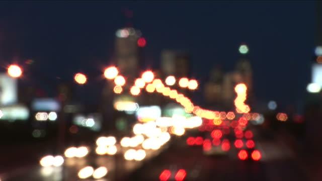view of traffic at night in toronto canada - ピント送り点の映像素材/bロール