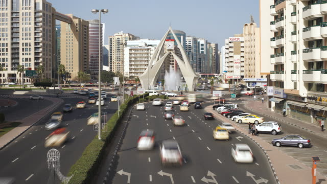 ws t/l view of traffic congestion at clock tower on al-maktoum road / dubai,united arab emirates - roundabout stock videos and b-roll footage