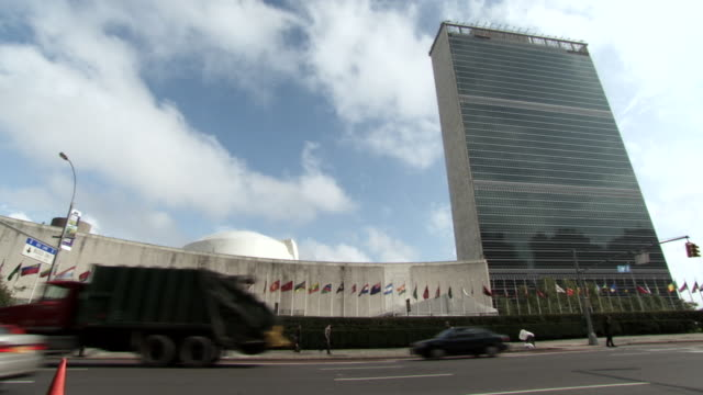 ws la view of traffic flows in front of the united nations headquarters building  / new york, united states - united nations building stock videos and b-roll footage
