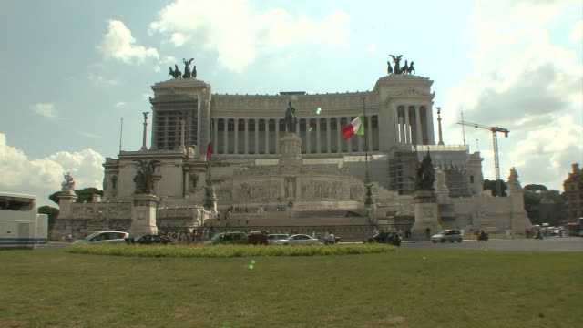 ws view of traffic in piazza venezia in front of victor emmanuel  ii monument / rome, italy   - piazza venezia stock videos and b-roll footage