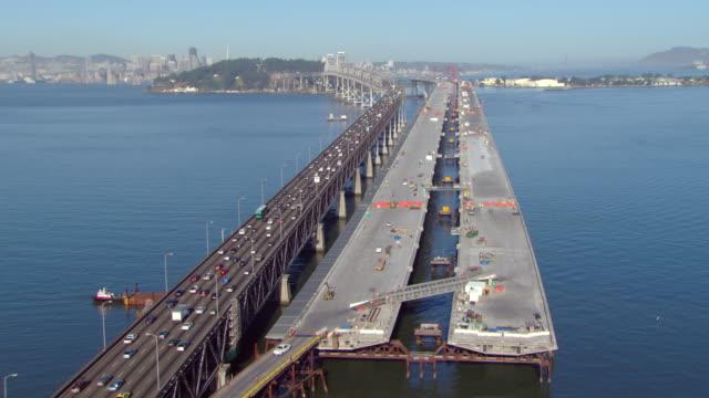 WS AERIAL View of traffic moving and construction along Bay Bridge / San Francisco, California, United States