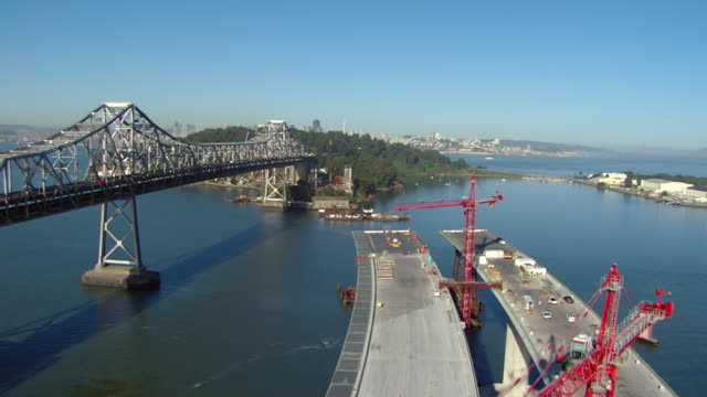 ws aerial view of traffic moving and construction along bay bridge / san francisco, california, united states - bauwerk stock-videos und b-roll-filmmaterial