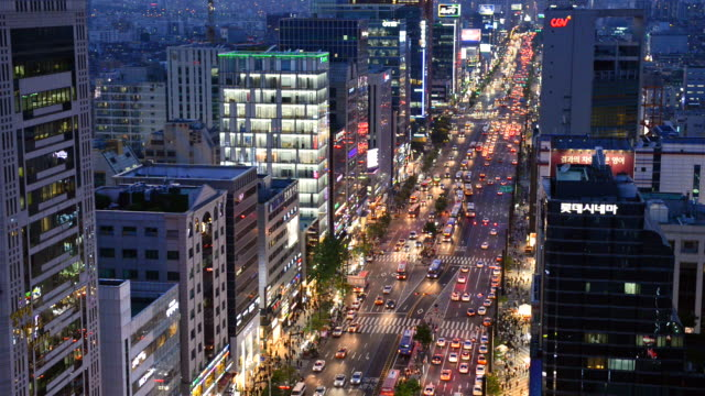 ws view of traffic moving at gangnam station area / seoul, south korea  - personal land vehicle stock videos & royalty-free footage