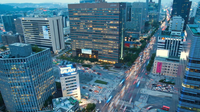 WS HA TD T/L View of Traffic moving at Gwanghwamun Square at sunset to night / Seoul, South Korea