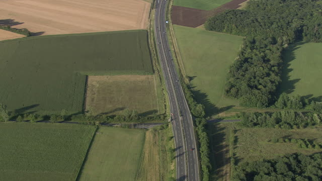 MS AERIAL View of traffic moving on A4 Motorway through farmland / Seine-et-Marne, France
